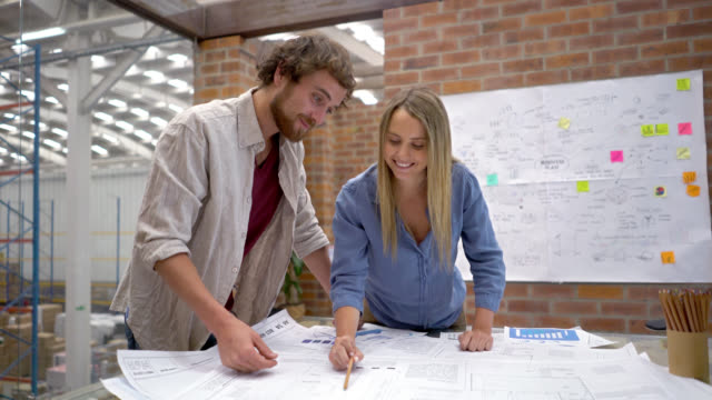 Architects looking at a blueprint