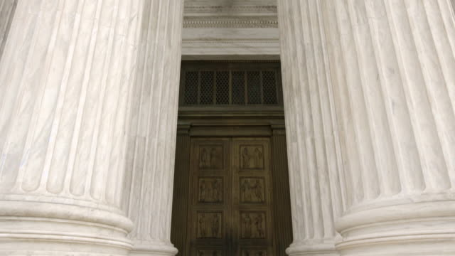 architectural columns and doors of the supreme court of the united states in washington, dc - u.s. supreme court stock videos & royalty-free footage