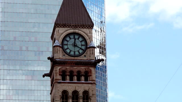 architectural contrast: clock tower in old city hall with modern building background - revival stock videos & royalty-free footage