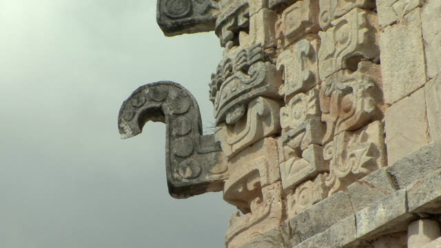 CU Architectural detail of mask of rain god Chaac at La Iglesia (The Church) in Las Monjas complex at pre-Columbian archaeological site built by Maya civilization / Chichen Itza, Yucatan, Mexico