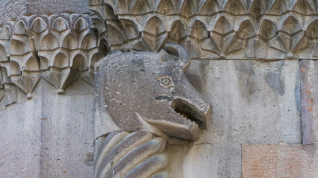 architectural details in etchmiadzin cathedral, etchmiadzin city, armavir province, armenia, middle east - rappresentazione di animale video stock e b–roll
