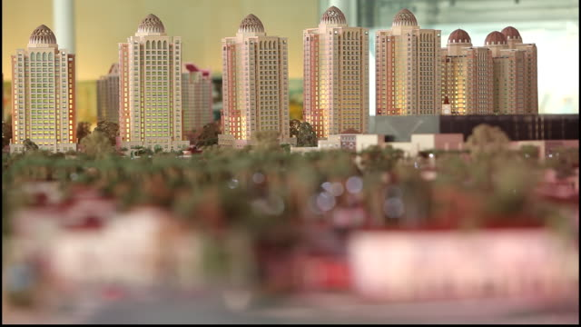 architectural maquette, doha, qatar. view of a miniature architectural scale model of the doha skyline with its imposing towers. - three dimensional stock videos & royalty-free footage