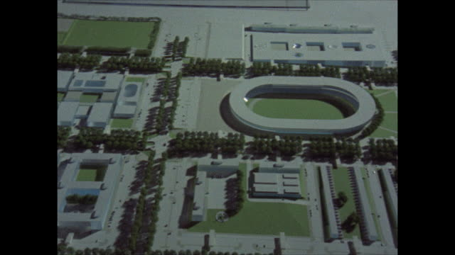vidéos et rushes de architectural model of the new city showing the planned public amenities such as a sports center and parkland aerial view of the countryside to be... - modèle réduit