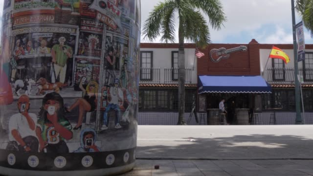 Architecture and decorated waste bins off 8th Street in Little Havana, Little Havana, Miami, Florida, United States of America, North America