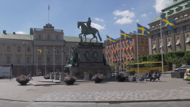 architecture and swedish flags on gustav adolfs torg, stockholm, sweden, scandinavia, europe - swedish flag stock videos and b-roll footage