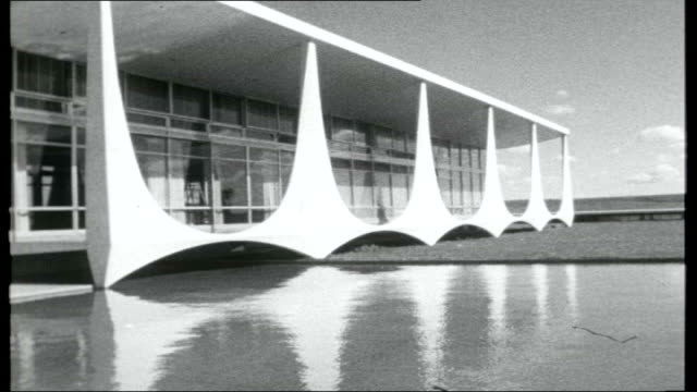 brazilian architect oscar niemeyer dies x08125901 / 1959 itn 'roving report south american journey brasilia' b/w moderniststyle buildings in brasilia... - oscar niemeyer stock videos and b-roll footage