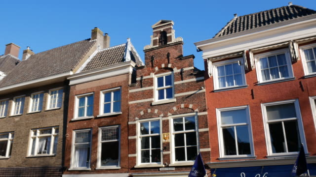 architecture in dutch town delft, south holland province, in autumn on sunny day - brick house stock videos & royalty-free footage