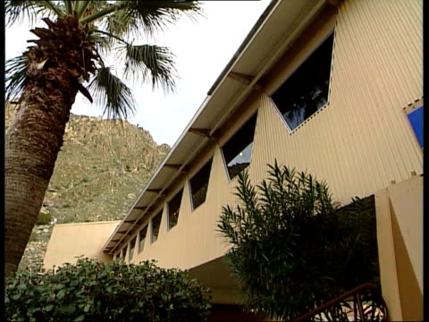 palm springs usa palm springs int leo marmol intvwd talks of rich and famous bringing architects to palm springs sky blue building with white roof... - awning stock videos and b-roll footage