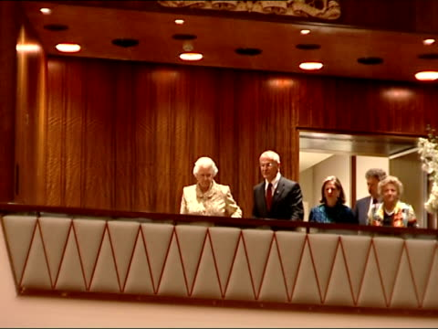 queen elizabeth opens newly-refurbished royal festival hall; queen elizabeth into full concert hall and orchestra perform national anthem sot - ロイヤルフェスティバルホール点の映像素材/bロール