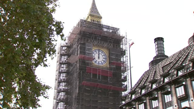 repair work to elizabeth tower and big ben clock face; england: london: westminster: ext gvs elizabeth tower clad in scaffolding during restoration... - scaffolding stock videos & royalty-free footage