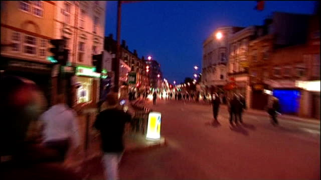 vídeos de stock e filmes b-roll de rye lane in peckham named a 'conservation' area; lib night riot police in peckham high street during rioting fireworks going off in high street... - peckham