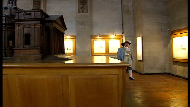sir christopher wren's buildings; int 'wren' with scale model for original design of st paul's cathedral inside cathedral crypt - crypt stock videos & royalty-free footage