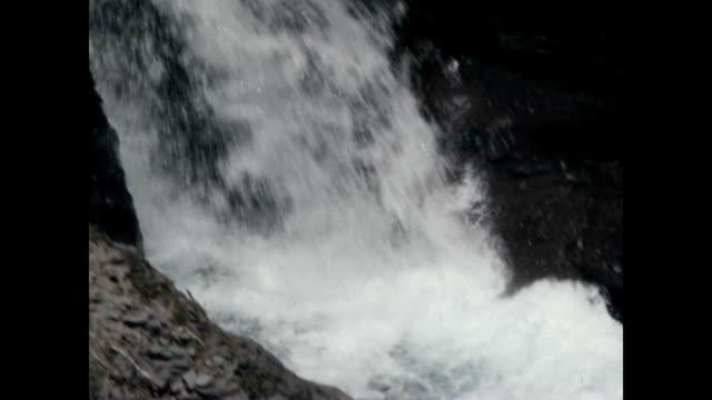 Archival film of Glacial water flow in the Cascade Mountain Range near Mount Rainier