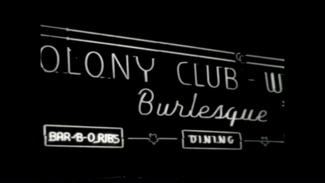 archival footage of spotlights and the neon signs for the colony club in the early 1960's. - バーレスク点の映像素材/bロール