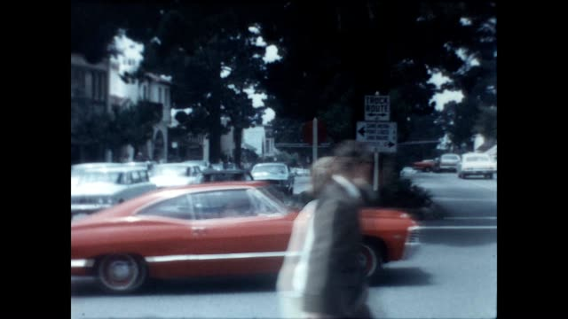 vídeos de stock, filmes e b-roll de archival home movie showing businesses and traffic on the corner of ocean ave and san carlos street / view of ocean. - península