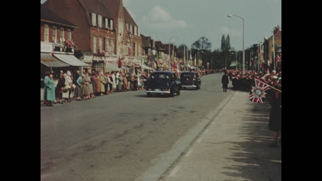 archive colour home movie footage of queen elizabeth ii driving through the town of potters bar on her way to visit the royal veterinary college on... - small town stock videos & royalty-free footage