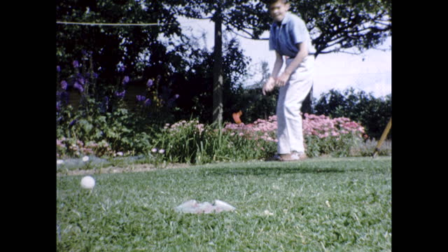 archive colour home movie footage of two boys playing mini golf in their garden in britain circa 1960s. - boys stock videos & royalty-free footage