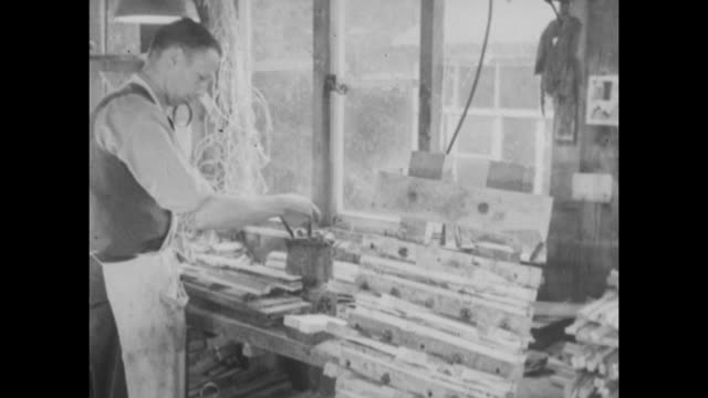 archive film footage circa 1939 of the cricket bat manufacturing process - クリケットバット点の映像素材/bロール