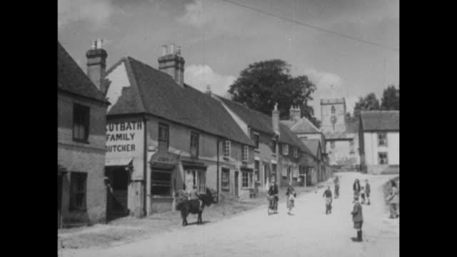 archive film footage circa 1939 of the village of hambledon and broadhalfpenny down one of the earliest cricket grounds in england - バッキンガムシャー点の映像素材/bロール