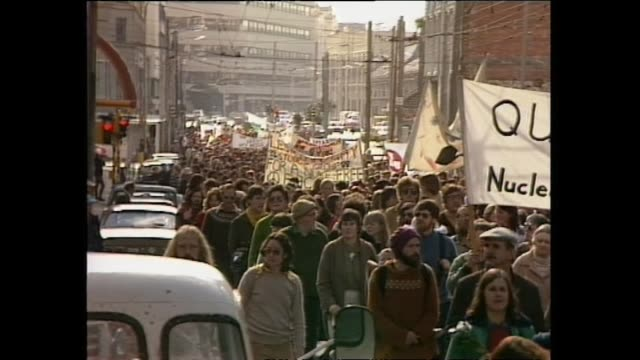 archive footage of antinuclear protest march coinciding with the nuclear ship uss texas visiting new zealand - 1983 stock videos & royalty-free footage