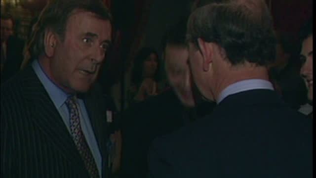 vidéos et rushes de archive footage of prince charles meeting terry wogan on december 13 2016 in unspecified unspecified region unspecified - terry wogan