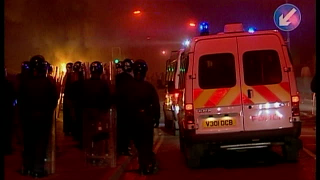 Archive footage of the Oldham riots which took place in May 2001 Riot police on scene with vehicles and dogs fires burning in the street and...
