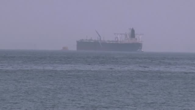 archive images shot on the 13th of may show saudi oil tanker amjad damaged in sabotage attacks anchored off the coast of the fujairah port as two of... - golfstaaten stock-videos und b-roll-filmmaterial