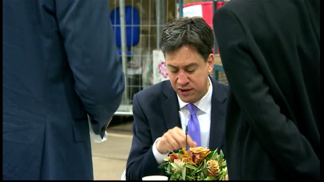 archive may 2010 showing exteriors of ed miliband labour leader in new covent garden flower market eating bacon sandwich drinking in cafe on 21st may... - ed miliband stock-videos und b-roll-filmmaterial
