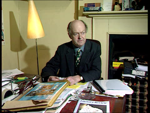 new government legislation ext new british library still being constructed reporter to camera london int auberon waugh reading copy of magazine... - bodleian library stock videos and b-roll footage