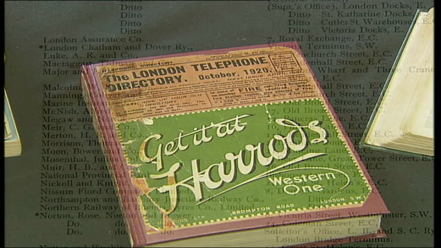 vídeos y material grabado en eventos de stock de launch of online versions of telephone directories; close up of gold lettering on london's first ever phone directory 1880 as book is opened dissolve... - directorio