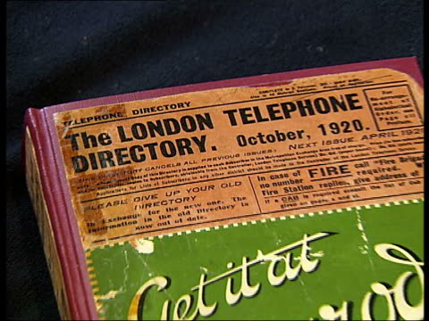 telephone directories displayed in company archive front cover of october 1920 london telephone directory with advertisement 'get it at harrods' - directory stock videos and b-roll footage