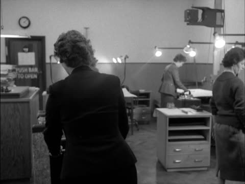 stockvideo's en b-roll-footage met archivists photograph the pages of bound volumes of newspapers at the british museum's newspaper library. - bbc archives