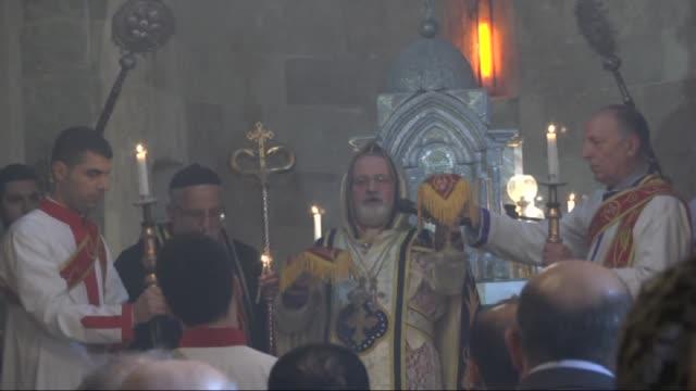 archpriest gabriel akyuz and metropolitan bishop of mardin and diyarbakir, saliba ozmen lead a christmas mass held to mark the birth of jesus christ... - キリスト降誕点の映像素材/bロール