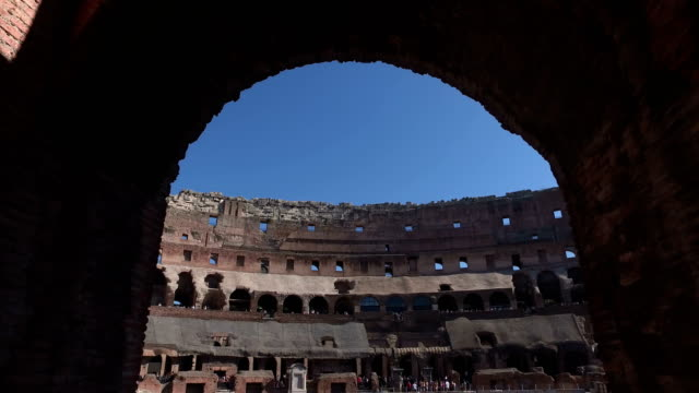 4k: archway inside the colosseum in rome, italy - walking through - arch architectural feature stock videos and b-roll footage