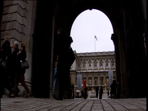 archway leading to courtyard of royal academy of arts with people walking by london - courtyard stock videos & royalty-free footage