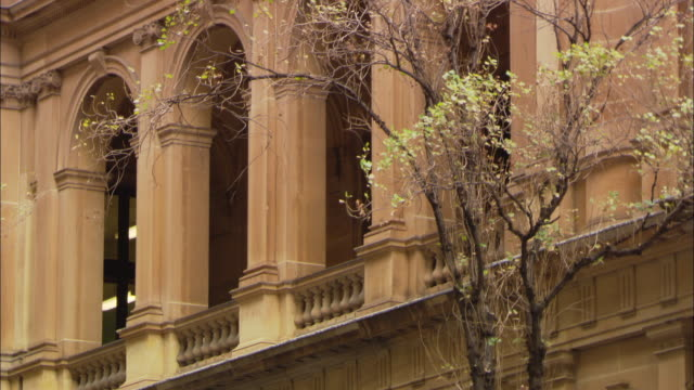 archways frame the balcony of a stone building in sydney, australia. - stone material stock videos & royalty-free footage