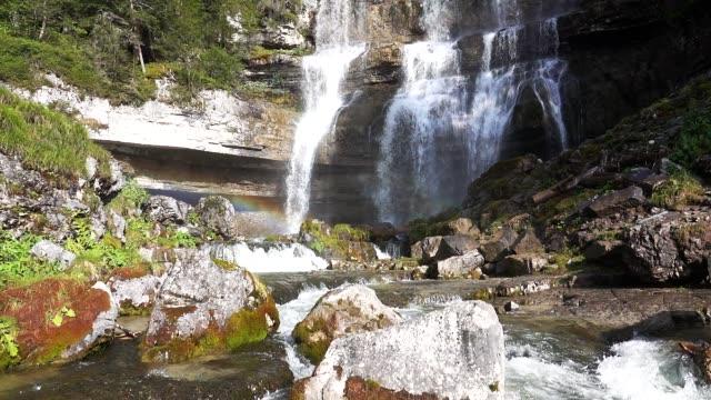 arcobaleno nella cascata di vallesinella nel bosco di pini - cascata stock videos and b-roll footage