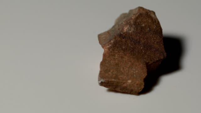 arcose sandstone mineral sample in rotation with white background