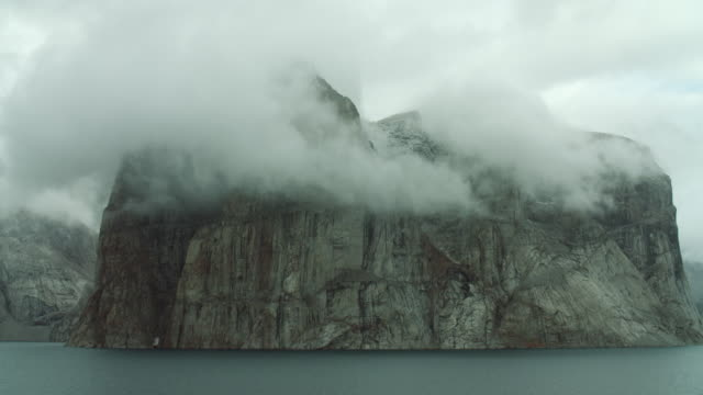 arctic cape obscured by low clouds - fjord stock videos & royalty-free footage