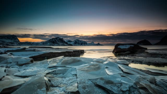 Arctic Coastline with Cracked Ice Floes - Time Lapse Tracking Shot