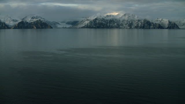 Arctic Landscape With Snowy Mountains And Sea