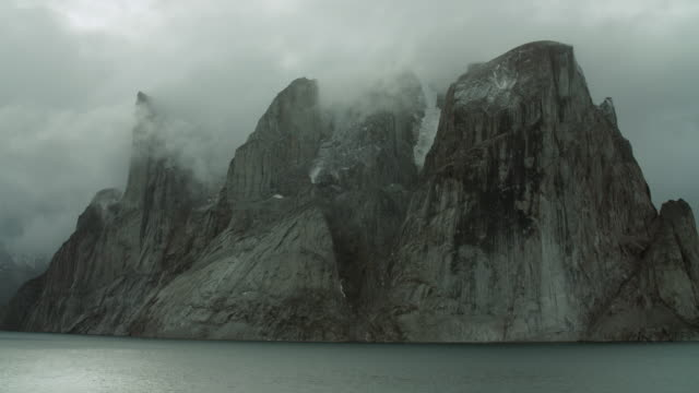 Arctic Promontory Shrouded By Clouds