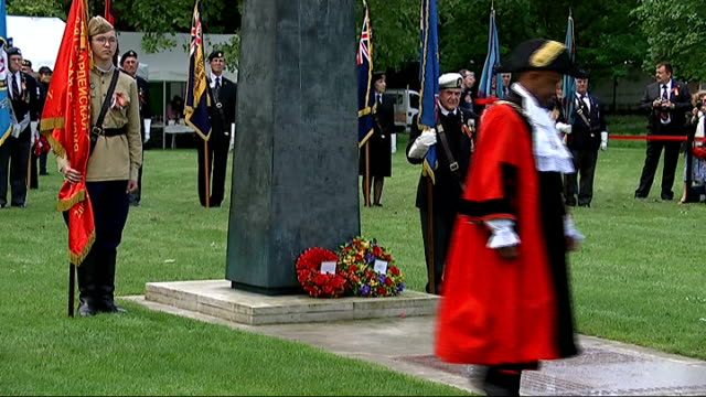 Arctic Star Veterans Medal Ceremony ENGLAND London EXT General views of ceremony / wreaths being laid at memorial / 'Last Post' played / VOX POPs...