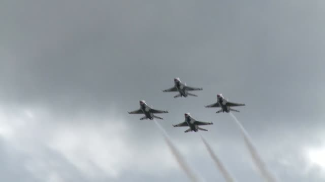 arctic thunder is a biennial event hosted by jber featuring more than 40 air force army and civilian aerial acts and with more than 200000 people in... - thunderbirds stock videos and b-roll footage