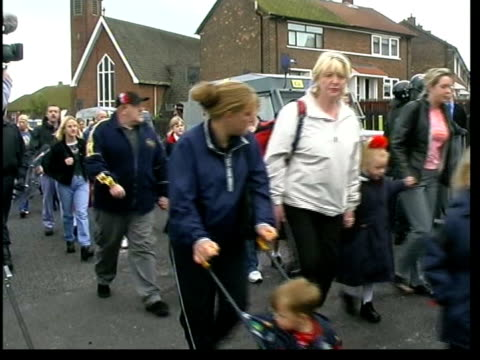 Ardoyne Protestant protests continue ITN NORTHERN IRELAND Belfast Ardoyne EXT GVs Parents and children away down street as making way home from Holy...