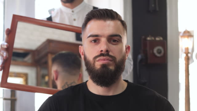 are you satisfied with your haircut? - barber chair stock videos & royalty-free footage
