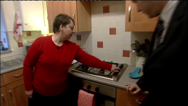 Area of Lancashire without gas and electricity following fire at substation INT Margaret Doolin showing reporter cooker with no gas and interview SOT