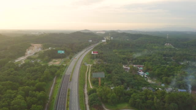 areal view of car driving along a countryside road in sunset - malaysia stock videos & royalty-free footage