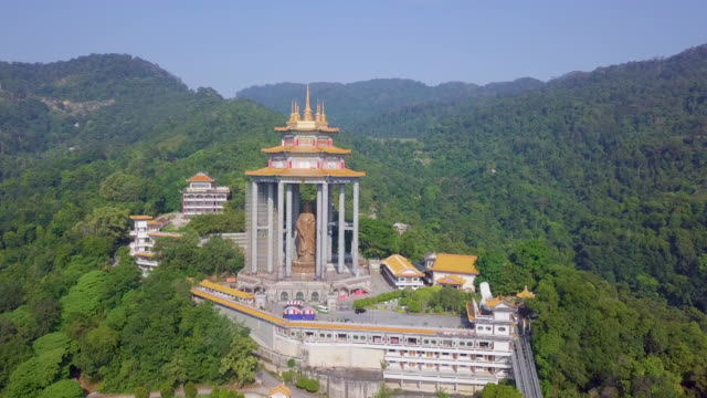 areial view of octagonal pavilion over the statue of guanyin - penang stock videos and b-roll footage
