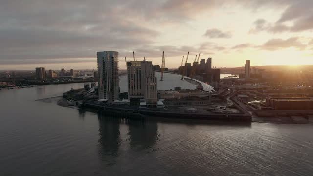 o2 arena and river thames at sunset, london, uk - 30 seconds or greater stock videos & royalty-free footage